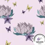 Puuvillane trikotaaž. Origami Lotus roosal taustal